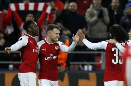Arsenal's Aaron Ramsey, second left, celebrates with teammates after scoring his side's second goal during the Europa League quarterfinal, second leg soccer match between CSKA Moscow and Arsenal at the CSKA Arena, in Moscow, Russia, Thursday, April 12, 2018. (AP Photo/Pavel Golovkin)