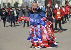 Memorabilia scarf seller ouside Old Trafford before the English Premier League soccer match between Manchester United and Chelsea at the Old Trafford stadium in Manchester, England, Sunday, Feb. 25, 2018. (AP Photo/Rui Vieira)