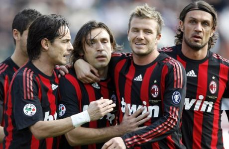 AC Milan midfielder Andrea Pirlo, third left, celebrates after scoring on a penalty kick with his teammates Filippo Inzaghi, left, David Beckham and Paolo Maldini, right, during the Serie A soccer match between Siena and AC Milan, at Siena's Artemio Franchi Stadium, Sunday March 15, 2009.  (AP Photo/Alessandra Tarantino)