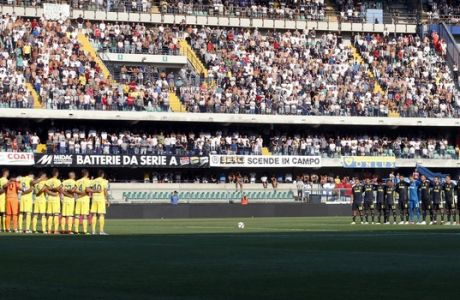 Juventus, right, and Chievo teams observe a minute of silence to honor the victims of the Genoa Morandi collapsed highway bridge, prior to the Serie A soccer match between Chievo Verona and Juventus, at the Bentegodi Stadium in Verona, Italy, Saturday, Aug. 18, 2018. (AP Photo/Antonio Calanni)