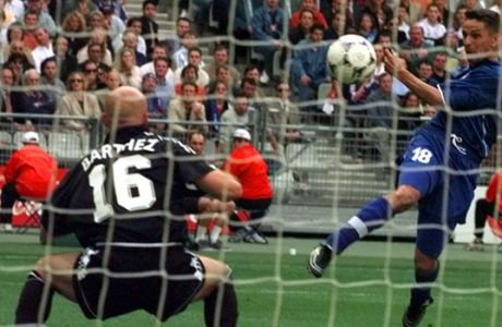 Italy's Roberto Baggio fires in a shot at French goalkeeper Fabien Barthez during the soccer World Cup 98 quarter final match between France and Italy at the Stade de France in Saint Denis, north of Paris, Friday July 3, 1998. France won the match 4-3 on penalties after the match ended 0-0 following extra time. (AP Photo/Luca Bruno)
