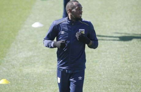 Jamaica's Usain Bolt trains with the Central Coast Mariners soccer team in Newcastle, Tuesday, Aug. 21, 2018. Bolt, who holds the world records for the 100- and 200-meter sprints and is an eight-time Olympic gold medalist, is hoping to impress the coaching staff enough to earn a contract with the Mariners for the 2018-19 season in Australia's top-flight competition. (AP Photo/Steve Christo)