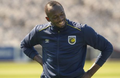 Jamaica's Usain Bolt reacts during training with the Central Coast Mariners soccer team in Newcastle, Australia, Tuesday, Aug. 21, 2018. Bolt's attempt to win a contract to play as a professional in Australian football's A-League began in earnest on his 32nd birthday Tuesday. (AP Photo/Steve Christo)