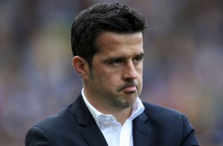 Hull City manager Marco Silva watches the English Premier League soccer match against Tottenham Hotspur at the KCOM Stadium, Hull, England, Sunday May 21, 2017. (Danny Lawson/PA via AP)