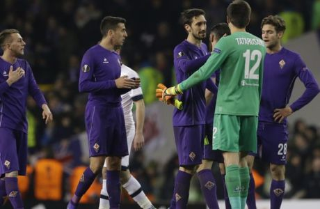 From left, Fiorentinas Federico Bernardeschi, Davide Astori, Matias Vecino , goalkeeper Ciprian Tatarusanu  and  Marcos Alonso react at the end of the Europa League round of 32 second leg soccer match between Tottenham Hotspur and Fiorentina at White Hart Lane stadium, in London, Thursday, Feb. 25, 2016. Tottenham won 3-0. Fiorentina as been eliminated from the tournament. (AP Photo/Matt Dunham)