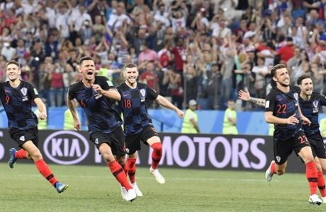 Croatia player celebrate after winning the round of 16 match between Croatia and Denmark at the 2018 soccer World Cup in the Nizhny Novgorod Stadium, in Nizhny Novgorod , Russia, Sunday, July 1, 2018. (AP Photo/Martin Meissner)