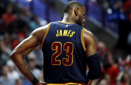 Cleveland Cavaliers forward LeBron James walks back to the bench during the second half of an NBA basketball game against the Chicago Bulls Thursday, March 30, 2017, in Chicago. The Bulls won 99-93. (AP Photo/Nam Y. Huh)
