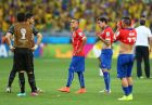 BELO HORIZONTE, BRAZIL - JUNE 28:  Chile players look dejected after being defeated by Brazil in a penalty shootout during the 2014 FIFA World Cup Brazil round of 16 match between Brazil and Chile at Estadio Mineirao on June 28, 2014 in Belo Horizonte, Brazil.  (Photo by Quinn Rooney/Getty Images)