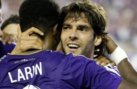 Orlando City's Kaka hugs teammate Cyle Larin (9) after Larin scored a goal against the Philadelphia Union during the second half of an MLS soccer game, Wednesday, May 25, 2016, in Orlando, Fla. The game ended in a 2-2 tie. (AP Photo/John Raoux)