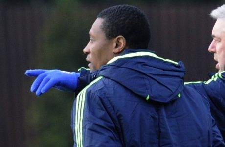 Chelsea manager Carlo Ancelotti, right, talks to his new assistant  Michael Emenalo at the Cobham training ground, Cobham, England, Monday, Nov. 22, 2010. Chelsea will face MSK Zilila in a Champions League group F soccer match at the Stamford Bridge stadium, London, Tuesday. (AP Photo/Tom Hevezi)