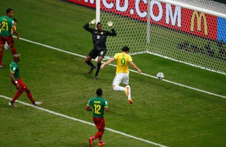BRASILIA, BRAZIL - JUNE 23: Fred of Brazil scores his team's third goal on a header past Charles Itandje of Cameroon during the 2014 FIFA World Cup Brazil Group A match between Cameroon and Brazil at Estadio Nacional on June 23, 2014 in Brasilia, Brazil.  (Photo by Phil Walter/Getty Images)
