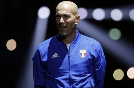 Former Real Madrid head coach Zinedine Zidane arrives to attend a charity soccer match between members of the 1998 World Cup winning French team and a team of international veteran players who were also involved in the same tournament, at the U Arena in Nanterre, north of Paris, France, Tuesday, June 12, 2018. (AP Photo/Thibault Camus)