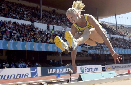Carolina Kluft of Sweden competes in the Heptathlon long jump at the World Athletics  Championships in Helsinki, Finland Sunday Aug. 7, 2005.(AP Photo/Thomas Kienzle)
