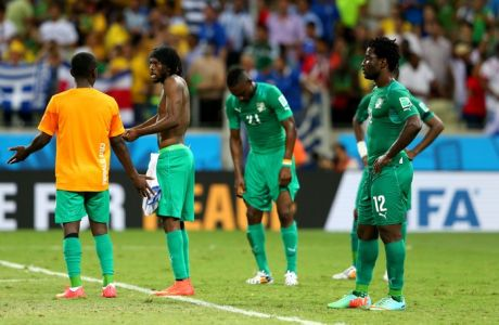 FORTALEZA, BRAZIL - JUNE 24:  Wilfried Bony (1st R) and the Ivory Coast players react after the 1-2 defeat in the 2014 FIFA World Cup Brazil Group C match between Greece and Cote D'Ivoire at Estadio Castelao on June 24, 2014 in Fortaleza, Brazil.  (Photo by Alex Livesey - FIFA/FIFA via Getty Images)