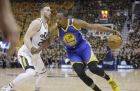 Utah Jazz forward Gordon Hayward (20) guards against Golden State Warriors forward Kevin Durant (35) who drives in the first half during Game 3 of the NBA basketball second-round playoff series Saturday, May 6, 2017, in Salt Lake City. (AP Photo/Rick Bowmer)