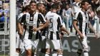 Juventus' Paulo Dybala, left, celebrates after scoring during the Serie A soccer match between Juventus and Crotone at the Juventus stadium, in Turin, Italy, Sunday, May 21, 2017. (AP Photo/Antonio Calanni)