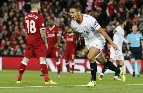 Sevilla's Wissam Ben Yedder celebrates after scoring during the Champions League group E soccer match between Liverpool and Sevilla at Anfield stadium in Liverpool, England, Wednesday, Sept. 13, 2017. (AP Photo/Frank Augstein)