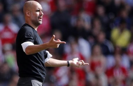 Manchester City head coach Pep Guardiola gestures during the English Premier League soccer match between Southampton and Manchester City at St Mary's Stadium in Southampton, Sunday, May 13, 2018. (AP Photo/Frank Augstein)