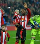 "Bradley Lowery is carried onto the pitch by Sunderland's Jermian Defoe during the Premier League match at the Stadium of Light, Sunderland. PRESS ASSOCIATION Photo. Picture date: Wednesday December 14, 2016. See PA story SOCCER Sunderland. Photo credit should read: Anna Gowthorpe/PA Wire. RESTRICTIONS: EDITORIAL USE ONLY No use with unauthorised audio, video, data, fixture lists, club/league logos or ""live"" services. Online in-match use limited to 75 images, no video emulation. No use in betting, games or single club/league/player publications."