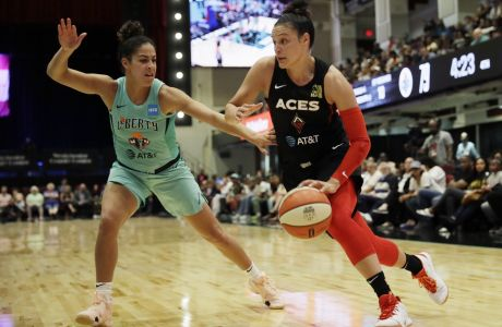 New York Liberty's Kia Nurse, left, defends against Las Vegas Aces' Kayla McBride in the second half of a WNBA basketball game, Sunday, June 9, 2019, in White Plains, N.Y. (AP Photo/Mark Lennihan)