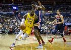 Los Angeles Lakers forward LeBron James (23) dribbles past Washington Wizards center Thomas Bryant (13) and guard Tomas Satoransky (31), of the Czech Republic, during the first half of an NBA basketball game, Sunday, Dec. 16, 2018, in Washington. (AP Photo/Al Drago)