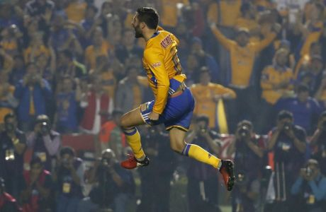 In this Sunday, Dec. 25, 2016 photo, Tigres' Andre Pierre Gignac celebrates after scoring during a penalty shootout against America during the Mexican soccer league final match in Monterrey, Mexico. Tigres won the Apertura 2016 Final on penalty kicks. (AP Photo/Eduardo Verdugo)