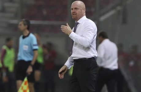 Burnley's coach Sean Dyche gestures during the Europa League playoffs, first leg, soccer match between Olympiacos Piraeus and Burnley at the Karaiskakis Stadium, in Athens, Greece, Thursday, Aug. 23, 2018.(AP Photo/Petros Giannakouris)