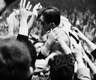 John Havlicek of the Boston Celtics is mobbed by fans and placed on their shoulders after the Celtics defeated the Philadelphia 76'ers 110 to 109 to win the Eastern Division Championship of the National Basketball Assn. at Boston Garden last night, April 16, 1965. Havlicek intercepted a Philadelphia throw-in, in the last seconds of the game, fed Sam Jones and both sprinted down the court when the Buzzer sounded. (AP Photo)