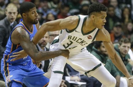 Milwaukee Bucks' Giannis Antetokounmpo tries to drive while being guarded by Oklahoma City Thunder's Paul George during the first half of an NBA basketball game Tuesday, Oct. 31, 2017, in Milwaukee. (AP Photo/Tom Lynn)