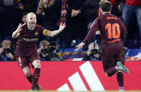 Barcelona's Lionel Messi, right, and his teammate Andres Iniesta celebrate the goal of their team during the Champions League, round of 16, first-leg soccer match between Chelsea and Barcelona at Stamford Bridge stadium, Tuesday, Feb. 20, 2018. (AP Photo/Frank Augstein)