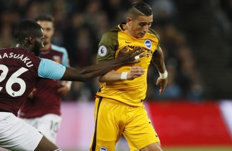 West Ham's Arthur Masuaku, left, stops Brighton's Anthony Knockaert during the English Premier League soccer match between West Ham and Brighton and Hove Albion at London Stadium in London, Friday, Oct. 20, 2017.(AP Photo/Kirsty Wigglesworth)