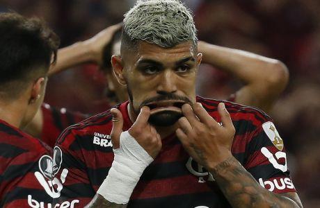 Ο Γκαμπριέλ Μπαρμπόσα με δύο γκολ μετά το 89' χάρισε στην Φλαμένγκο τη νίκη με σκορ 2-1 στον τελικό του Copa Libertadores, απέναντι στην Ρίβερ Πλέιτ (AP Photo/Leo Correa)