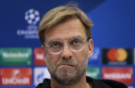 Liverpool's manager Jurgen Klopp answers questions during a news conference ahead of the Champions League soccer match between Spartak Moscow and Liverpool in Moscow, Russia, on Monday, Sept. 25, 2017. (AP Photo/Ivan Sekretarev)