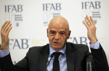 FIFA President Gianni Infantino speaks during a press conference after the 131st International Football Association Board (IFAB) annual general meeting at Wembley stadium in London, Friday, March 3, 2017.  Sin bins and rolling substitutions will be allowed in the lower levels of soccer after being approved by the game's lawmaking body. (AP Photo/Frank Augstein)