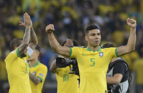 Brazil's Casemiro, right, celebrates his team's 2-0 victory over Argentina after a Copa America semifinal soccer match at Mineirao stadium in Belo Horizonte, Brazil, Tuesday, July 2, 2019. (AP Photo/Eugenio Savio)