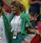 Iranian soccer fans cheer as they wait for the group B match between Iran and Spain at the 2018 soccer World Cup in the Kazan Arena in Kazan, Russia, Wednesday, June 20, 2018. (AP Photo/Frank Augstein)