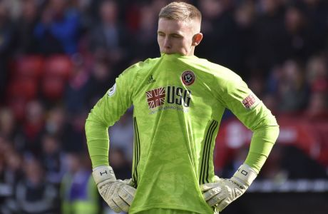 Sheffield United's goalkeeper Dean Henderson reacts during the English Premier League soccer match between Sheffield United and Liverpool at Bramall Lane in Sheffield, England, Saturday, Sept. 28, 2019. (AP Photo/Rui Vieira)