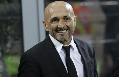 Roma coach Luciano Spalletti smiles prior to an Italian Serie A soccer match between Inter Milan and Roma, at the San Siro stadium in Milan, Italy, Sunday, Feb. 26, 2017. (AP Photo/Luca Bruno)