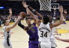 Los Angeles Lakers forward Kyle Kuzma, second from left, tries to shoot past Milwaukee Bucks guard Pat Connaughton, left, forward Giannis Antetokounmpo and guard Tony Snell during the second half of an NBA basketball game Friday, March 1, 2019, in Los Angeles. The Bucks won 131-120. (AP Photo/Mark J. Terrill)