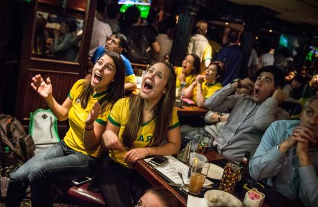 NEW YORK, NY - JUNE 12:  Brazilian soccer fans react after Brazil's first goal in the Brazil vs. Croatia World Cup game at Legends Bar on June 12, 2014 in New York City. Brazil vs Croatia is the first game of the World Cup, which will take place throughout Brazil until Sunday, July 13.  (Photo by Andrew Burton/Getty Images)