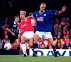 Arsenal's Dennis Bergkamp (left) holds off Leicester City's Spencer Prior during their Carling Premiership match at Filbert St Wednesday Aug 27 1997.(AP Photo/ Rui Viera)