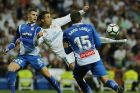Real Madrid's Cristiano Ronaldo, centre, tries a shot on goal during a Spanish La Liga soccer match between Real Madrid and Espanyol at the Santiago Bernabeu stadium in Madrid, Spain, Sunday, Oct. 1, 2017. (AP Photo/Paul White)
