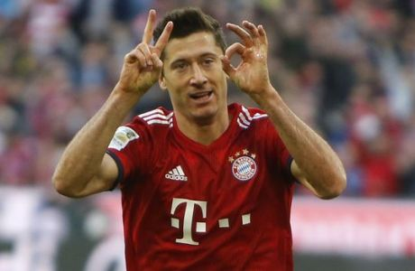 Bayern's Robert Lewandowski celebrates after scoring his side's second goal during the German Bundesliga soccer match between FC Bayern Munich and Borussia Dortmund in the Allianz Arena in Munich, Germany, on Saturday, April 6, 2019. (AP Photo/Michael Probst)