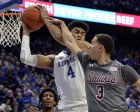 S Illinois guard Marcus Bartley (3) fouls Kentucky forward Nick Richards (4) on a rebound during the second half of an NCAA college basketball game in Lexington, Ky., Friday, Nov. 9, 2018. Kentucky won 71-59. (AP Photo/Timothy D. Easley)