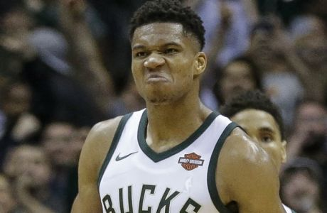 Milwaukee Bucks' Giannis Antetokounmpo reacts after making the go-ahead basket against Portland Trail Blazers during the second half of an NBA basketball game Saturday, Oct. 21, 2017, in Milwaukee. (AP Photo/Tom Lynn)