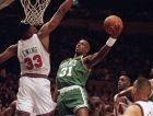 Xavier McDaniel (31) of the Boston Celtics shoots over the outstretched arms of Patrick Ewing (33) of the New York Knicks during NBA action at Madison Square Garden in New York, Jan. 11, 1993. The Celtics outlasted a lasted a late Knicks surge to win 100-97. (AP Photo/Ron Frehm)