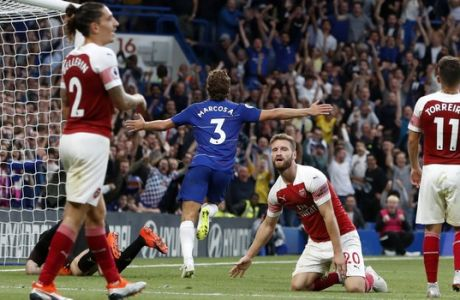 Chelsea's Marcos Alonso, center, celebrates after scoring his side's third goal during the English Premier League soccer match between Chelsea and Arsenal at Stamford bridge stadium in London, Saturday, Aug. 18, 2018. (AP Photo/Alastair Grant)