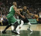 Milwaukee Bucks' Giannis Antetokounmpo drives against Boston Celtics' Al Horford during the first half of an NBA basketball game Thursday, Feb. 21, 2019, in Milwaukee. (AP Photo/Aaron Gash)