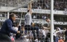 A fan swings on the goalpost as the pitch is invaded after the English Premier League soccer match between Tottenham Hotspur and Manchester United at White Hart Lane stadium in London, Sunday, May 14, 2017. It was the last Spurs match at the old stadium, a new stadium is being built on the site. (AP Photo/Frank Augstein)