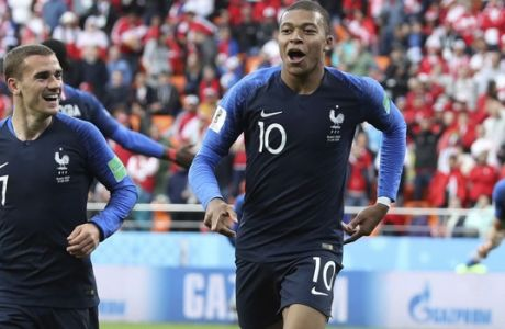 France's Kylian Mbappe, left celebrates with teammate France's Antoine Griezmann after scoring the opening goal of the game during the group C match between France and Peru at the 2018 soccer World Cup in the Yekaterinburg Arena in Yekaterinburg, Russia, Thursday, June 21, 2018. (AP Photo/David Vincent)